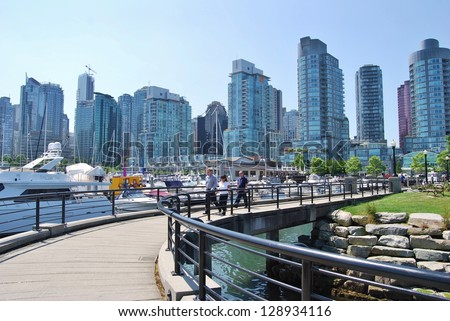 VANCOUVER, CA- JUNE 25: Downtown Vancouver Waterfront, and Lifestyle on June 25 , 2011 in Vancouver, CA Vancouver has prominent buildings in a variety of styles by many famous architects.
