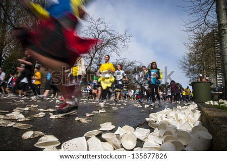 VANCOUVER, CANADA - APRIL 21:  Athletes participate in the 2013 Vancouver Sun Run, April 21, 2013. Many runners wore blue and yellow in support of the Boston marathon, where bombings occurred earlier. - stock photo