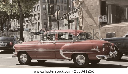 VANCOUVER, CANADA - AUGUST 6, 2005: Chevrolet Bel Air in Vancouver. This vintage car is a full-size automobile that was produced by the Chevrolet division of General Motors.  - stock photo