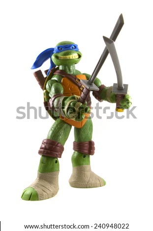 VANCOUVER, CANADA - DECEMBER 30, 2014 A Teenage Mutant Ninja Turtles toy isolated on white. They were made popular in the 80's and 90's and expanded into a cartoon series, films, video games and toys.