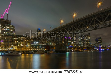 Vancouver Canada - December 15, 2017: Granville bridge and Vancouver Downtown at night time view from Granville Island.