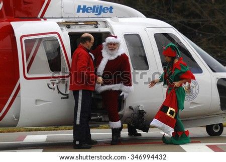 VANCOUVER, CANADA - DECEMBER 16, 2014: Santa Claus arrives at BC Children's Hospital via helicopter to deliver presents to kids on the hospitals' pediatric wards in Vancouver, Canada, Dec.16, 2014.
