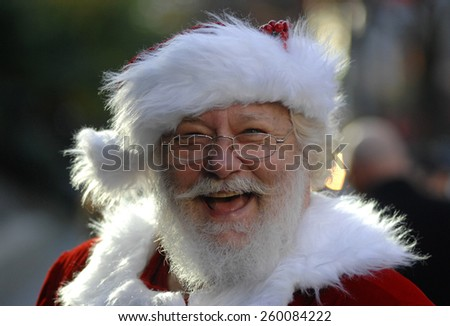 VANCOUVER, CANADA - DECEMBER 2, 2012: Santa Claus pose during The Santa Claus Parade in Vancouver, Canada, on December 2, 2012. - stock photo