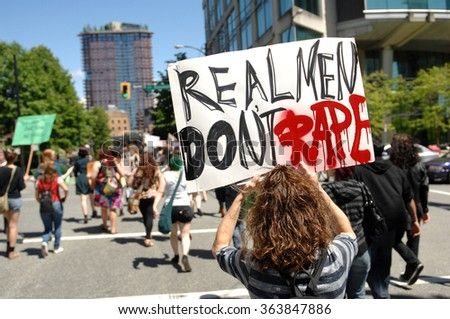 VANCOUVER, CANADA - JULY 7, 2014: Hundreds of women and men marched the streets of downtown during SlutWalk protest against sexual assault in Vancouver, Canada, on July 7, 2014. - stock photo