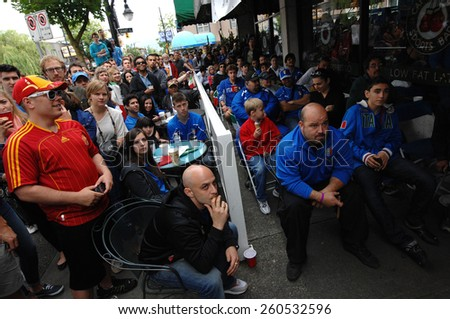 VANCOUVER, CANADA - JULY 1, 2012: Italian fans watch the final match of EURO 2012 Italy vs. Spain on July 1, 2012  in Vancouver, Canada. - stock photo