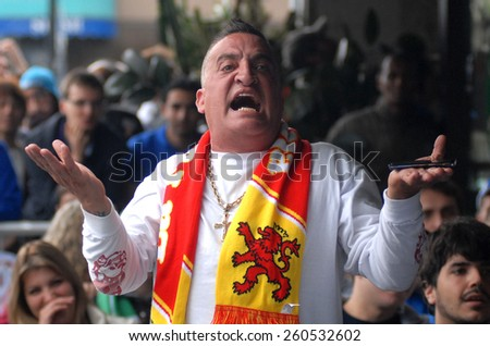 VANCOUVER, CANADA - JULY 1, 2012: Spanish fan watches the final match of EURO 2012 Italy vs. Spain on July 1, 2012  in Vancouver, Canada. - stock photo