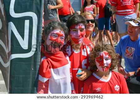 VANCOUVER, CANADA - JUNE 27, 2015: Canadian fans arrive to BC Place Stadium for FIFA Women's World Cup Canada 2015 match Canada again England. England won 2-1