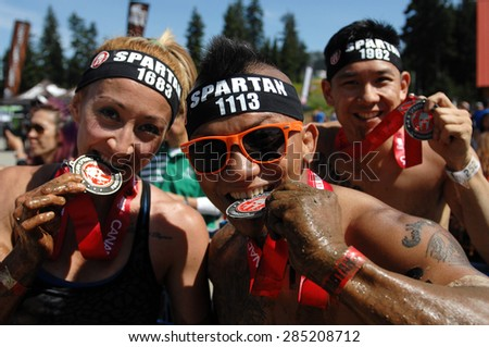 VANCOUVER, CANADA - JUNE 6, 2015: Competitors participate in the 2015 Spartan Race obstacle racing challenge in Vancouver, Canada, on June 6, 2015. - stock photo