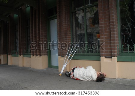 VANCOUVER, CANADA - JUNE 1, 2012: Homeless people, like pictured ones, can be seen almost on every corner of every street in the heart of downtown in Vancouver, Canada, June 1, 2012. - stock photo