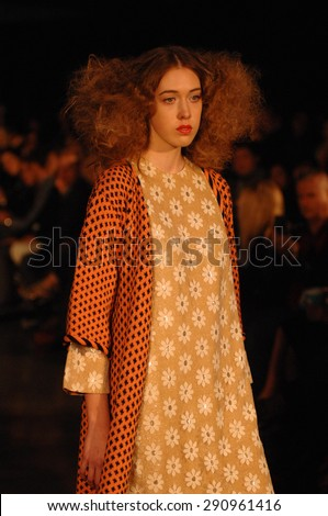 VANCOUVER, CANADA - MARCH 17, 2015: A model presents fashion creation during Vancouver Fashion Week in Vancouver, Canada, March 17, 2015. - stock photo