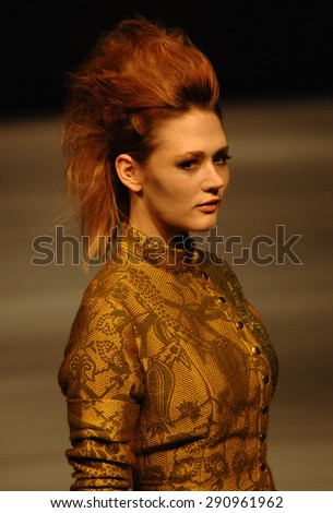 VANCOUVER, CANADA - MARCH 22, 2015: A model presents fashion creation during Vancouver Fashion Week in Vancouver, Canada, March 22, 2015. - stock photo