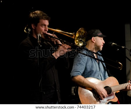 VANCOUVER, CANADA - MARCH 27: Trio Starbirds. Nick La Riviere and Tom Landa on the stage of The Jazz Cellar on March 27, 2011 in Vancouver, Canada. - stock photo