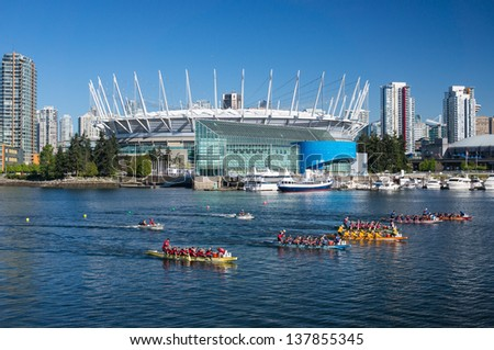 VANCOUVER, CANADA - MAY 05: Rowers take part in dragon boat race at False Creek in Vancouver on May 05, 2013. Dragon boating today is the fastest growing international team water sport.