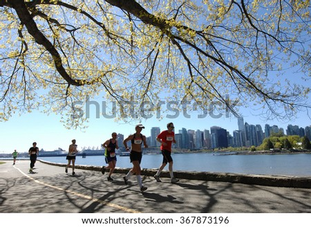 VANCOUVER, CANADA - MAY 3, 2015: Runners take part in the 44th annual BMO Vancouver Marathon in Vancouver, Canada, on May 3, 2015.  - stock photo