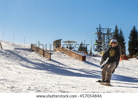 VANCOUVER, CANADA: NOVEMBER 2014: Person Snowboarding at Grouse Mountain Ski Resort - stock photo
