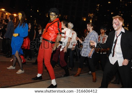 VANCOUVER, CANADA - OCTOBER 30, 2013: Hundreds of colorfully dressed people gathered in downtown to take part in Halloween celebrations in Vancouver, Canada, October 30, 2013. - stock photo