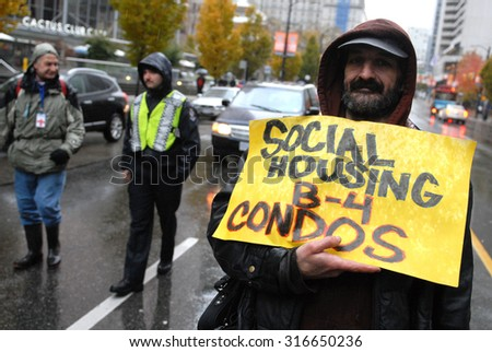 VANCOUVER, CANADA - OCTOBER 23, 2011: Hundreds of people marched the streets to protest against corporate greed, as part of global Occupy movement, in Vancouver, Canada, Oct.23, 2011. - stock photo
