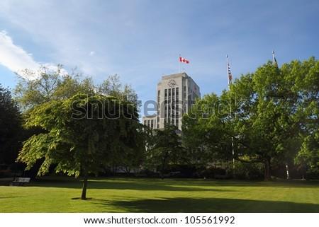Vancouver City Hall, British Columbia. The Vancouver City Hall building and surrounding lawn and trees. Vancouver, British Columbia, Canada. - stock photo