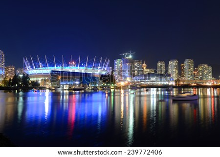 Vancouver City skyline and BC Place Stadium at night, Vancouver, British Columbia, Canada - stock photo