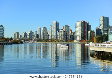 Vancouver City skyline and high rise apartment at the north bank of False Creek, Vancouver, British Columbia, Canada - stock photo