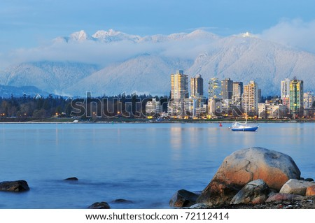 vancouver cityscape with grouse mountain in background - stock photo