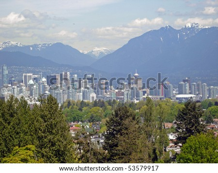 Vancouver downtown view with snow mountain background.