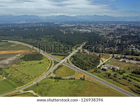 Vancouver - Highway with bridge by the fields and forest - stock photo
