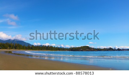 Vancouver Island. Evening low tide on the Pacific beach wet sand and puddles - stock photo