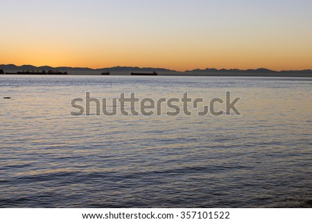 Vancouver Island, horizon with sunset above mountains - stock photo