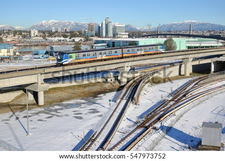VANCOUVER - JANUARY 2, 2017: Vancouver, BC's Skytrain heads east before crossing a Skybridge on its' way to the downtown core on January 2, 2017.