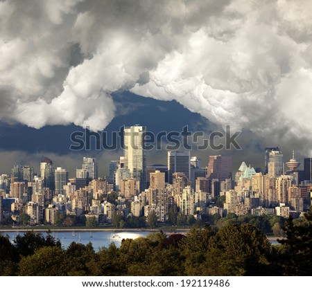 Vancouver (May 2014) with English Bay in sunset with heavy clouds and fog - stock photo