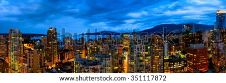 Vancouver panorama cityscape at night. Illuminated buildings against deep blue sky. - stock photo