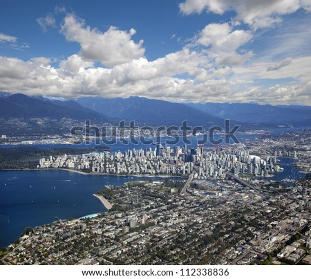 Vancouver - panoramic aerial view with downtown, Kitsilano beach and Coast Mountains - stock photo