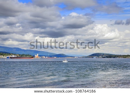 Vancouver Sea landscape against expressive cloudy sky. British Columbia,Canada - stock photo