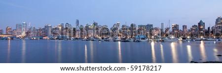 Vancouver skyline panoramic at night - stock photo