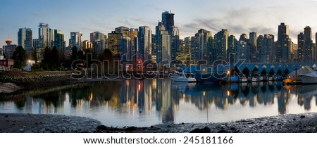 Vancouver Skyline. The beautiful Vancouver skyline taken from Stanley Park during sunset. The city marina can be seen in the foreground. - stock photo