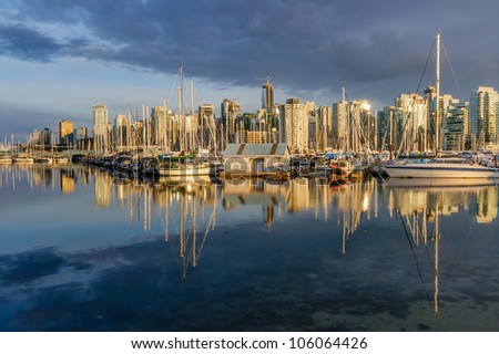 Vancouver skyline with Coal Harbour marina in the foreground - stock photo