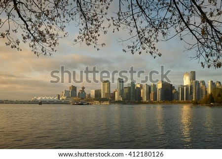 Vancouver Sunrise Skyline. Downtown Vancouver seen from Stanley Park on a sunny morning. Vancouver, British Columbia, Canada.  - stock photo