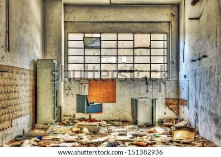 Vandalized office equipment and debris in an abandoned factory - stock photo