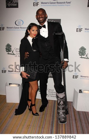 Vanessa Laine Bryant and Kobe Bryant with broken leg at An Unforgettable Evening Presented by Saks Fifth Avenue, Beverly Wilshire Hotel, Beverly Hills, CA 05-02-13 - stock photo