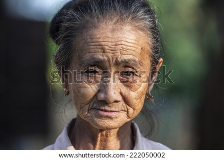 VANG VIENG, LAOS, JULY 12, 2012: Portrait of a Laotian old woman in the village of Vang Vieng in Laos.