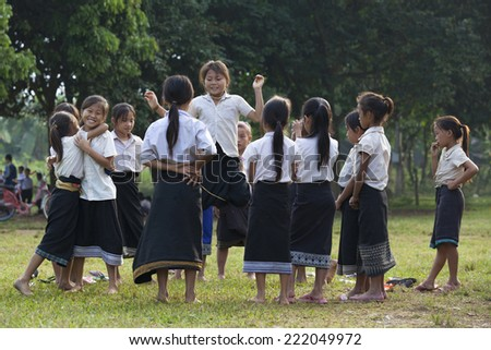 VANG VIENG, LAOS - July 12: young unidentified girls playing in school on July 12, 2012 in Vang Vieng, Laos.