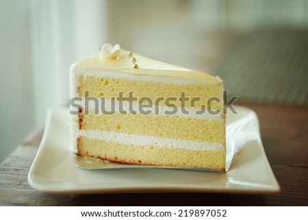 Vanilla cake topping with white chocolate - stock photo