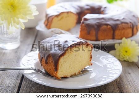 Vanilla cake with chocolate icing - stock photo