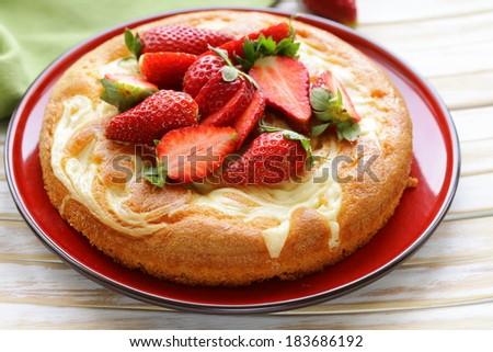 vanilla cake with fresh strawberries - summer pastries - stock photo