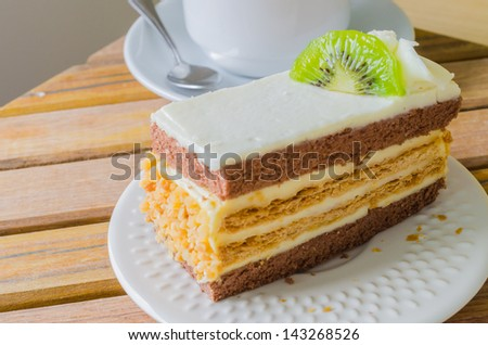 Vanilla cake with kiwi on white dish