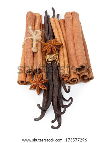 Vanilla, cinnamon and star anise spices isolated on white - stock photo
