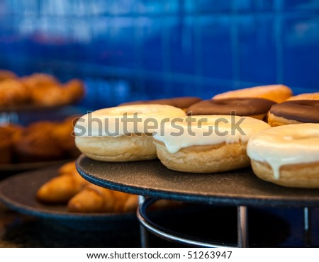 Vanilla Covered Donuts on a buffet tray