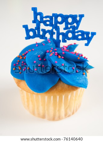 Vanilla Cupcake with Bright Blue Icing and Happy Birthday Sign - stock photo