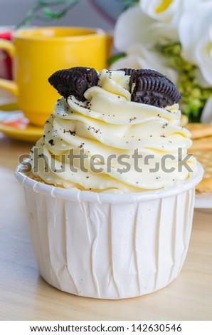 Vanilla cupcake with cookie - stock photo